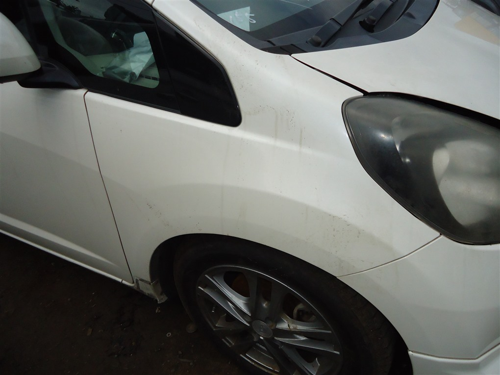 Крыло Honda Fit GE8 L15A 2011 переднее правое белый nh624p 1409