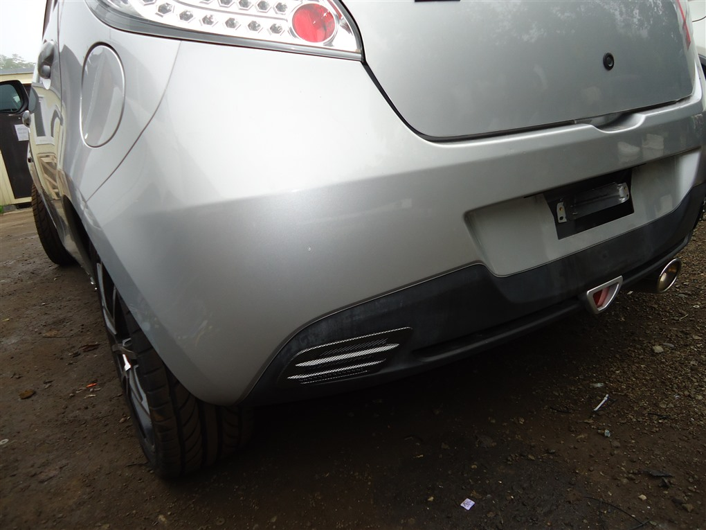 Бампер Mazda Demio DE5FS ZY-VE 2007 задний серебристый 22v 1414