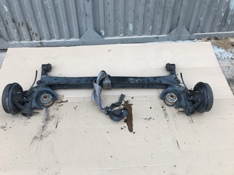 Балка со ступицами Toyota Bb NCP31 задняя