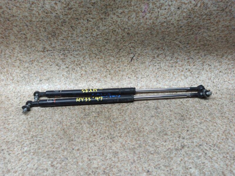 Амортизатор капота Nissan Cedric HY33