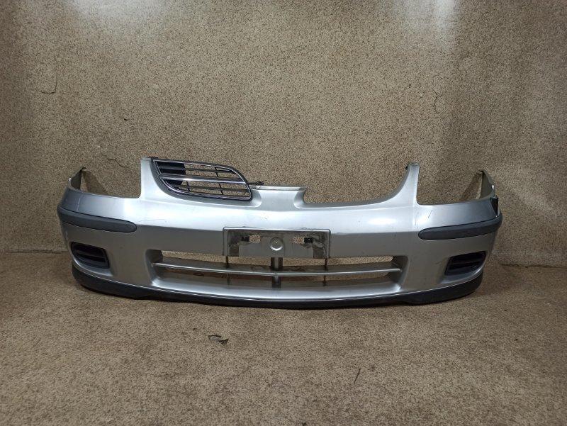 Бампер Nissan Tino V10 передний