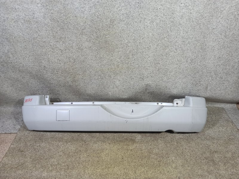 Бампер Mitsubishi Pajero Io H66W 2000 задний
