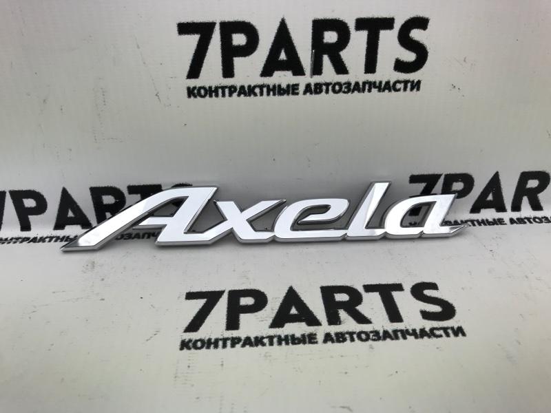 Эмблема Mazda Axela