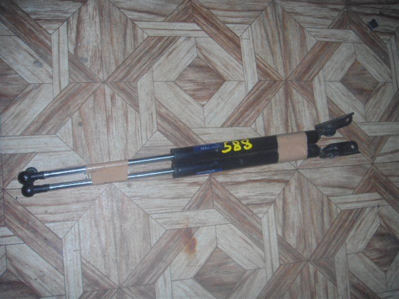 Амортизатор 5-ой двери Daihatsu Coo M411S задний ст.902000588