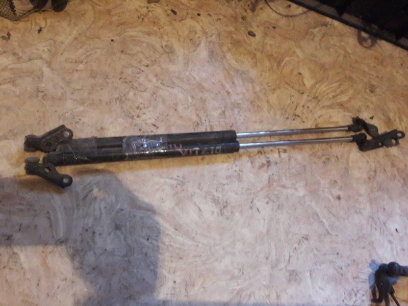 Амортизатор багажника Toyota Vitz SCP10 SCP13 1SZ 2002