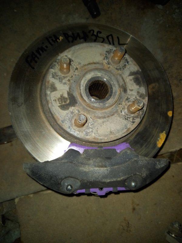 Тормозной диск Mazda Familia BHA3S B3ME 1997 передний