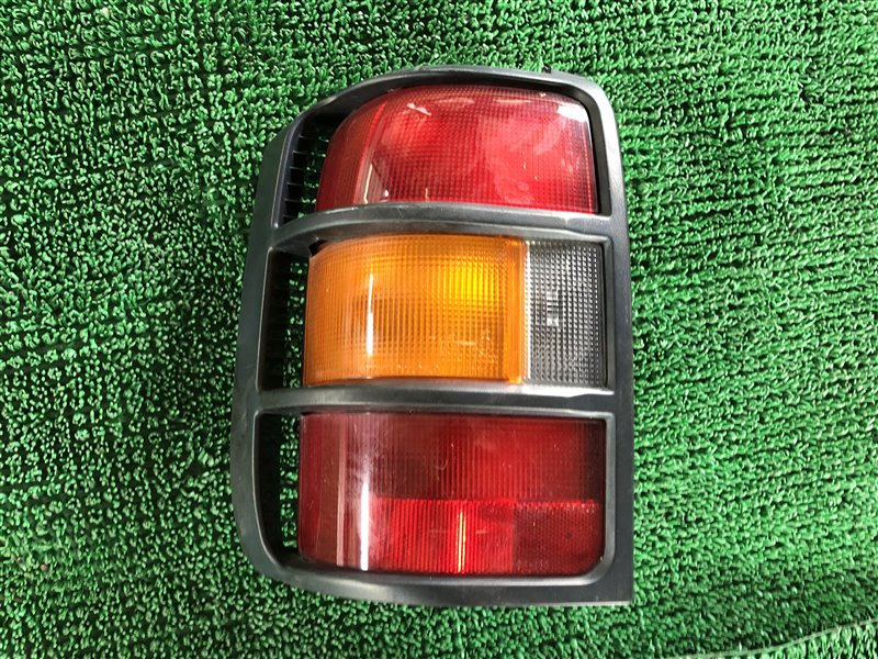 Стоп-сигнал Mitsubishi Pajero Evolution V55W 6G74 2005 задний левый (б/у)