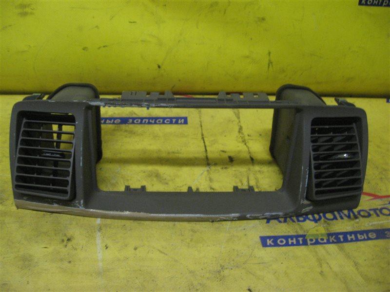 Панель под магнитофон Toyota Corolla Fielder NZE121 1NZ-FE