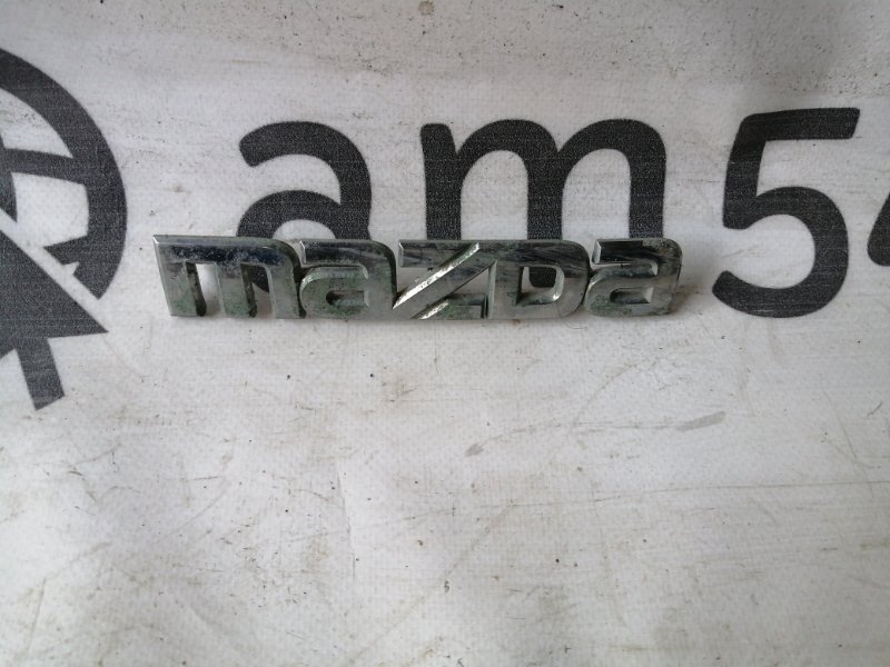 Эмблема Mazda Demio DY3W ZJ-VE