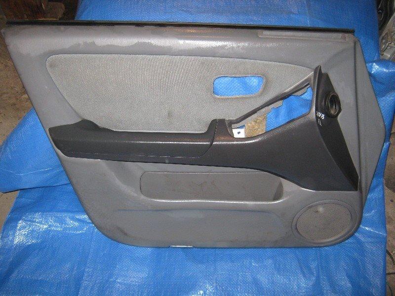 Обшивка двери Toyota Harrier SXU10W передняя левая