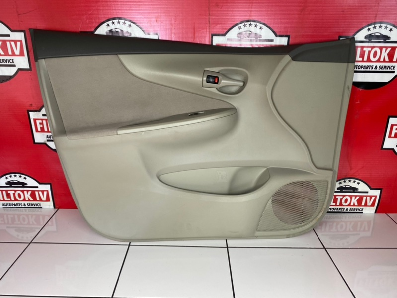 Обшивка двери Toyota Corolla Axio NZE141 1NZFE 2006 передняя левая