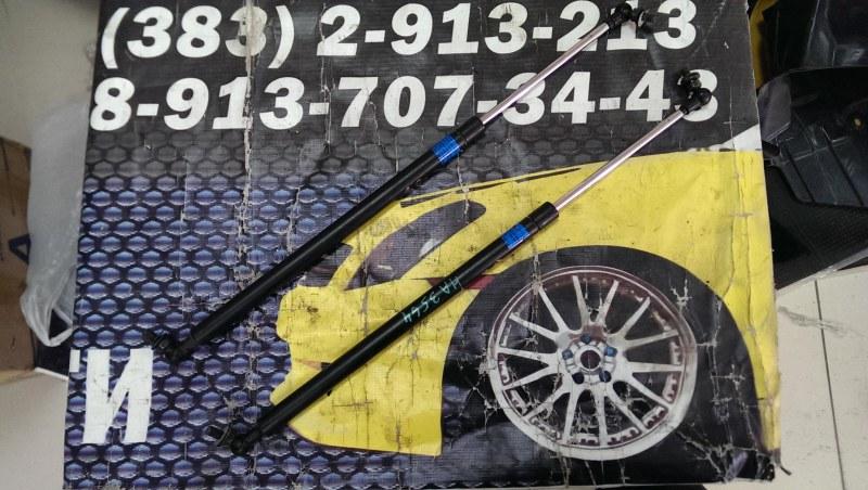Амортизатор капота Subaru Outback BRD EE20Z 2014 левый SUBARU 57251-AJ010