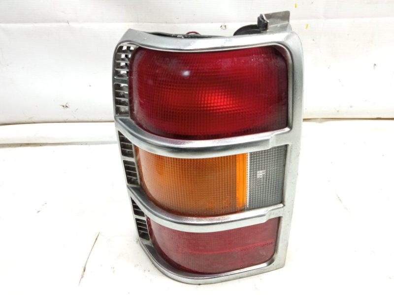 Стоп-сигнал Mitsubishi Pajero V21W 4M40T 1995 задний левый