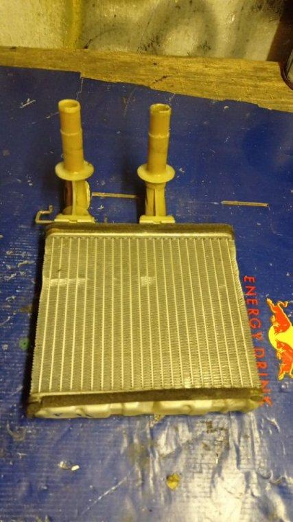 Радиатор печки Nissan Avenir W11