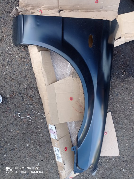 Крыло Mazda 323 BJ ZLDE переднее правое