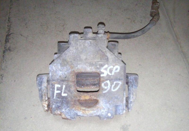 Суппорт Toyota Yaris SCP90 2SZ-FE 2008 передний левый