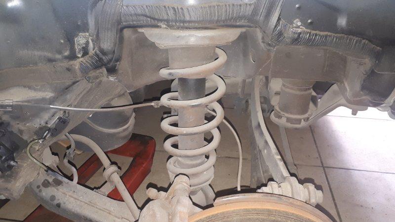 Стойка подвески Toyota Avensis AZT251 2AZ-FSE 2007 задняя левая