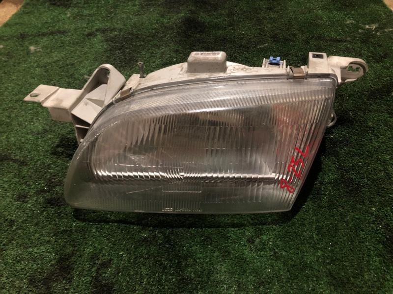 Фара Ford Festiva D23PF B3 левая