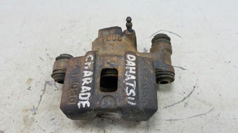 Тормозной суппорт Daihatsu Charade G100 передний левый