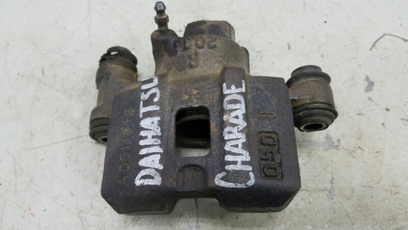 Тормозной суппорт Daihatsu Charade G100 передний правый