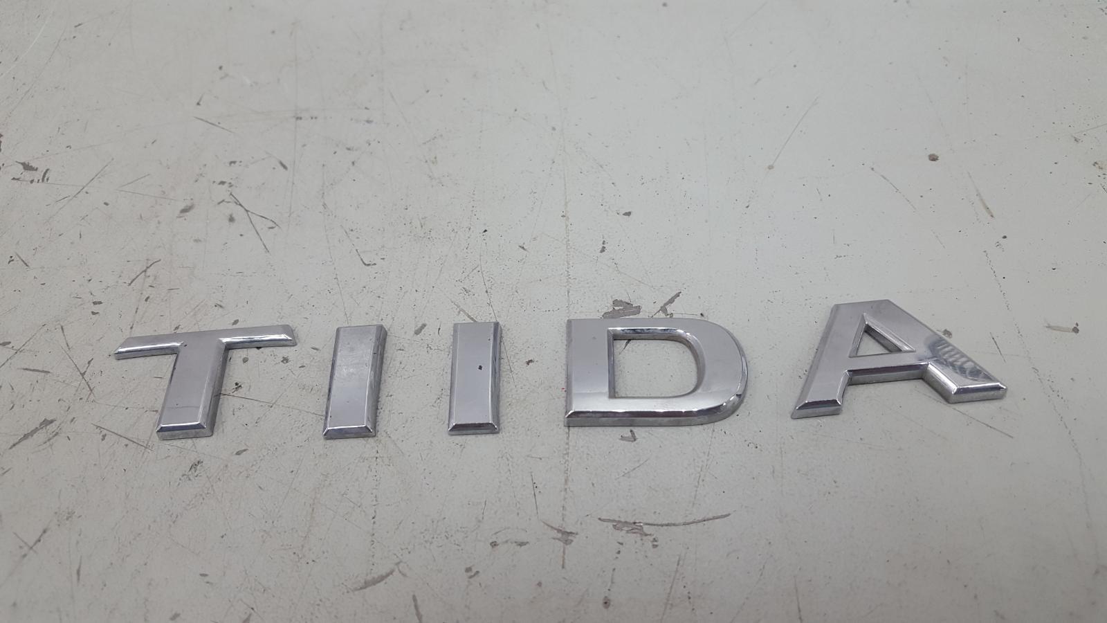 Эмблема Nissan Tiida C11X HR16DE 2008