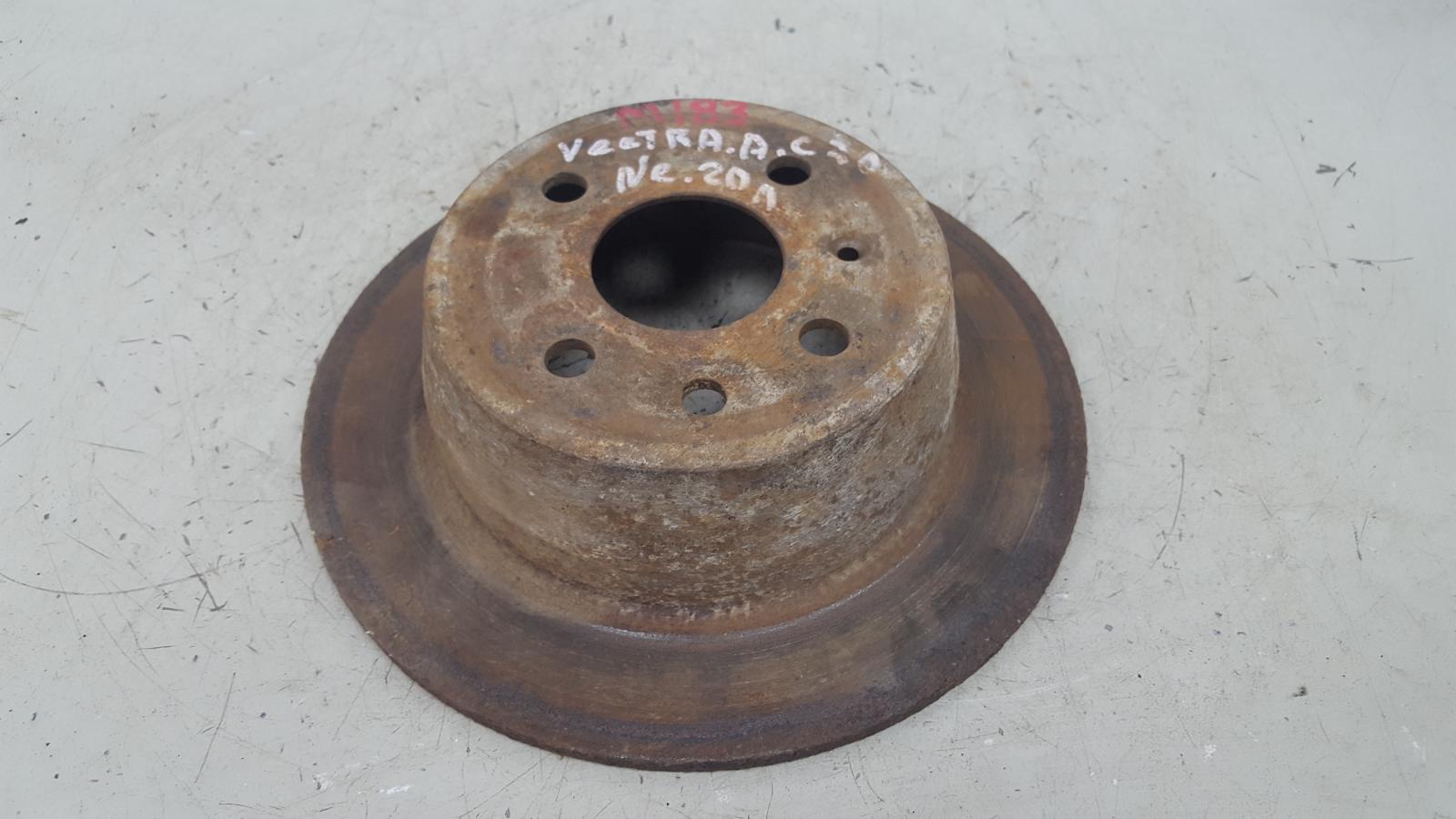 Тормозной диск Opel Vectra A C20NE 2.0Л 1993 задний