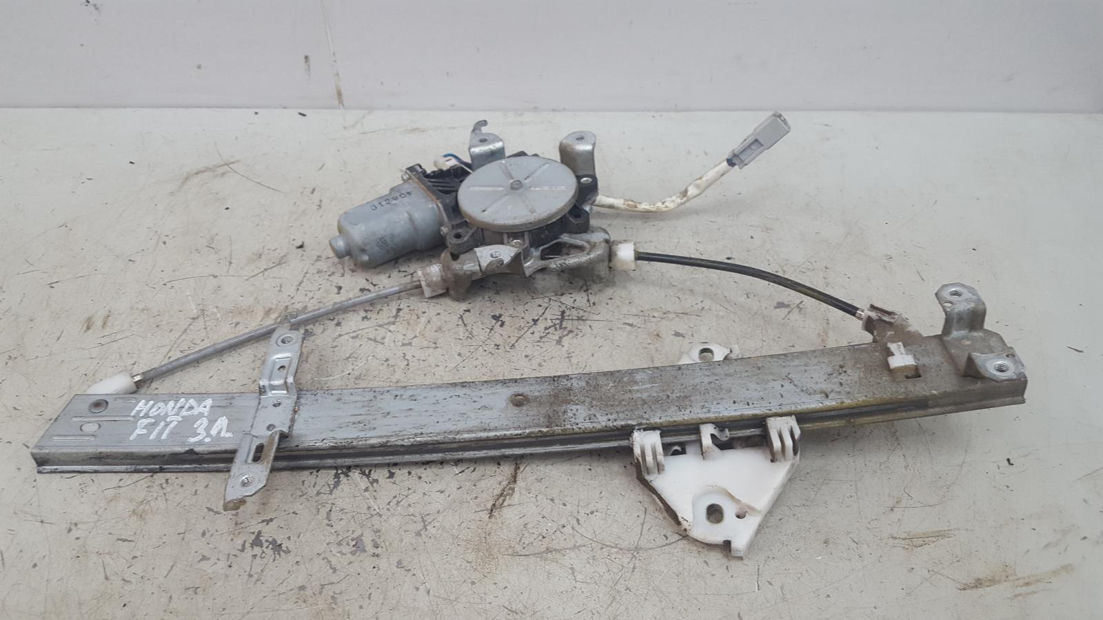 Стеклоподъемник электрический Honda Fit GD1 задний левый