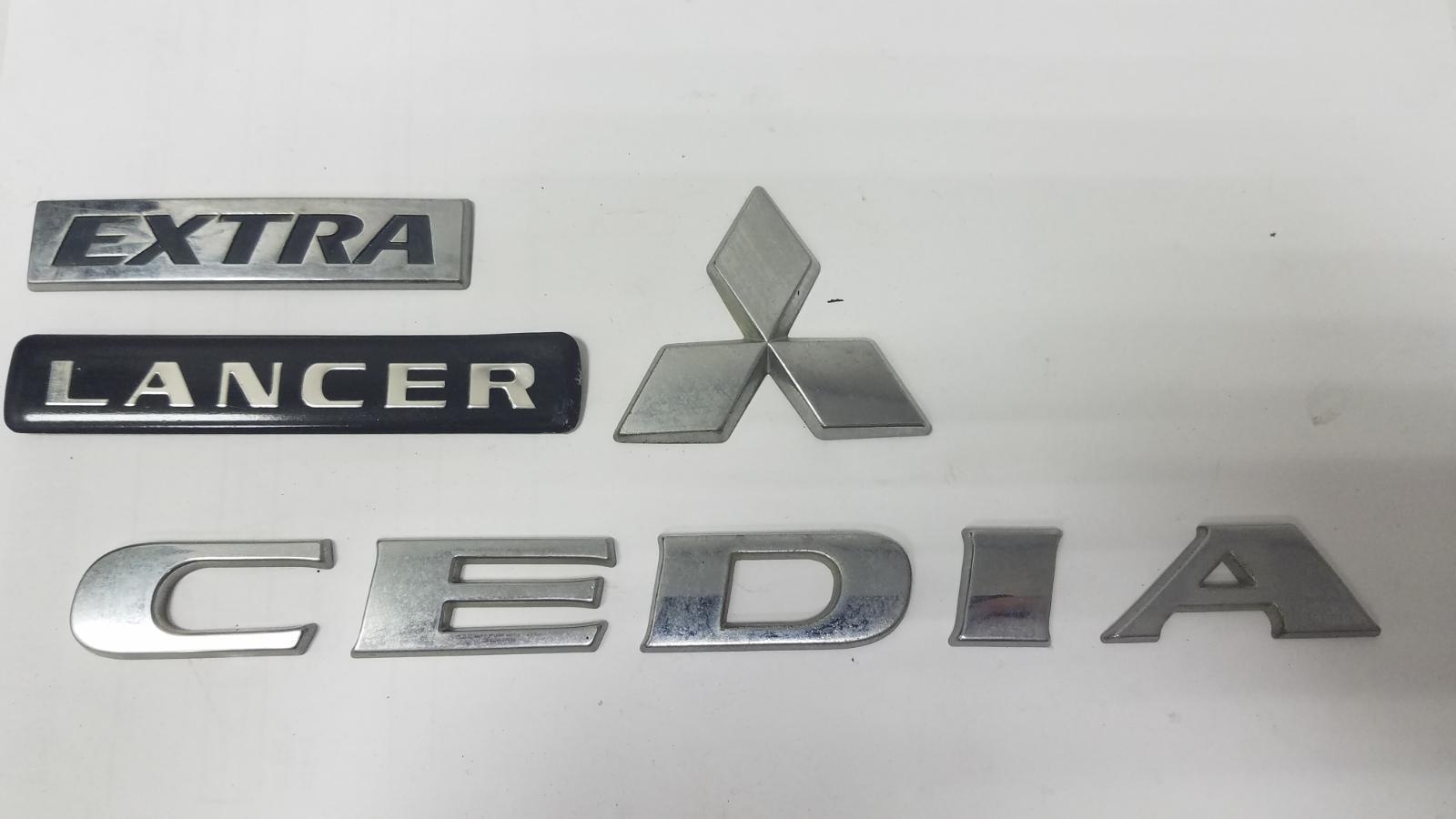 Эмблема Mitsubishi Lanser Cedia CS2A 4G15 2002 задняя
