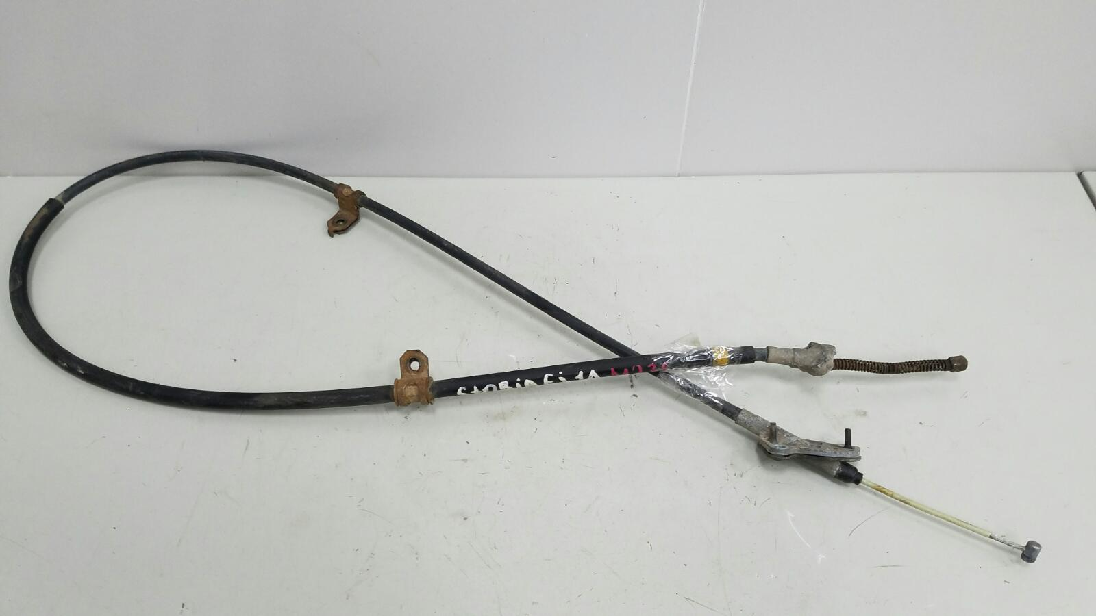 Трос ручного стояночного тормоза ручника Daihatsu Storia M100S EJ 1Л 2003