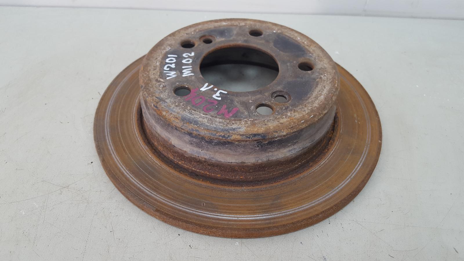 Тормозной диск Mercedes A190 W201 M102.961 2.0Л 1984 задний левый