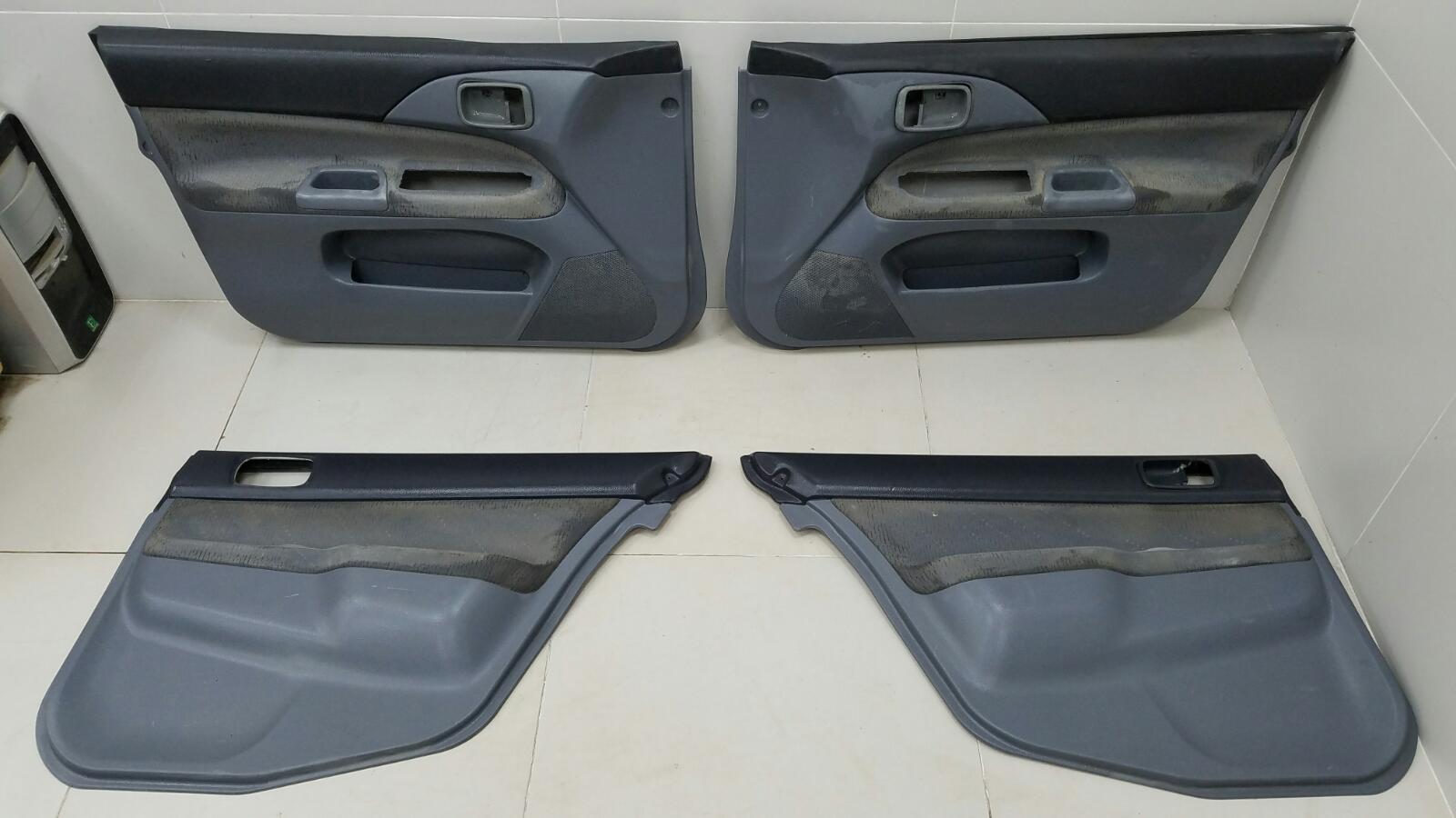 Комплект обшивок карт дверей Mitsubishi Lancer Cedia CS2A 4G15 2002