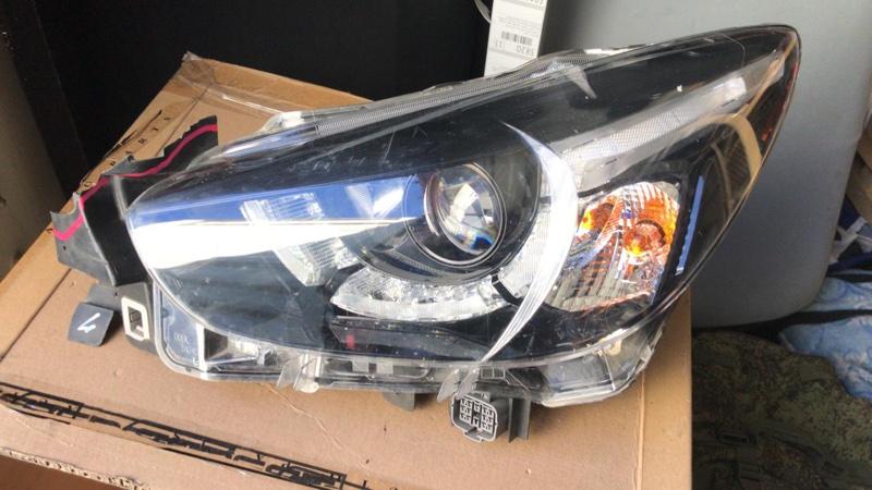 Фара Mazda Demio DJ3FS левая