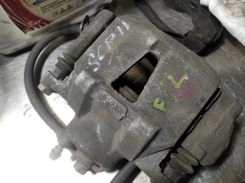 Суппорт Toyota Vitz SCP10 1SZFE передний левый