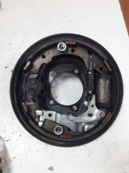 Механизм стояночного тормоза Toyota Ipsum SXM10 задний левый