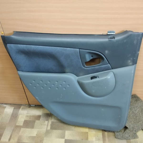 Обшивка двери Toyota Funcargo NCP20 задняя левая