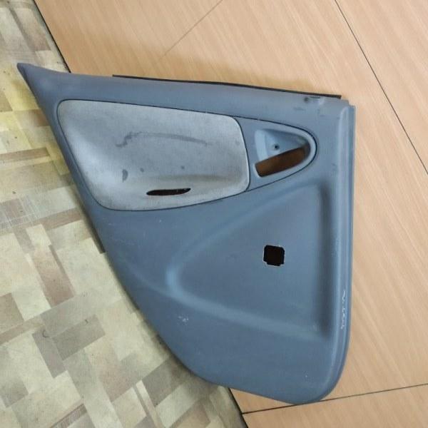 Обшивка двери Toyota Platz NCP10 задняя левая