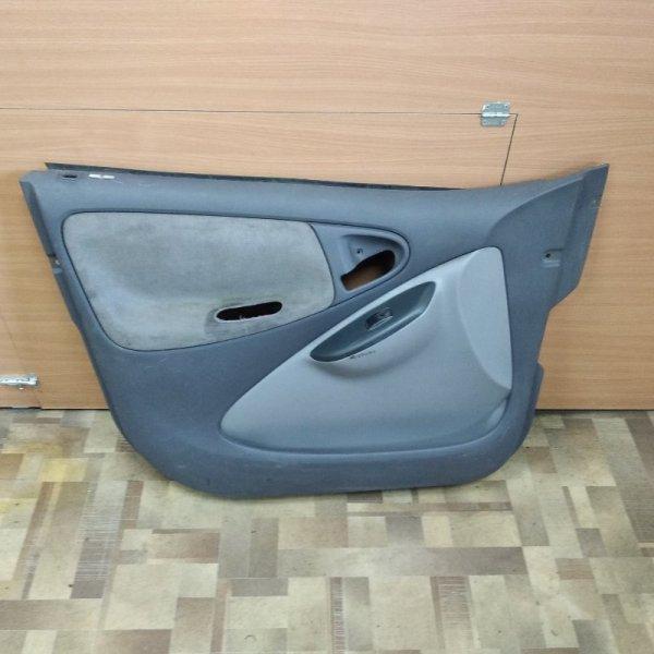Обшивка двери Toyota Platz SCP10 передняя левая