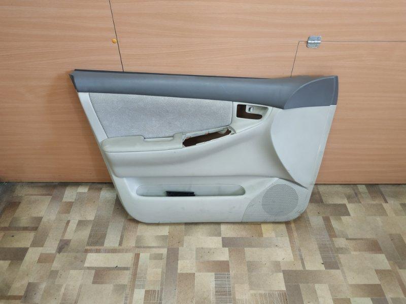 Обшивка двери Toyota Corolla NZE121 передняя левая