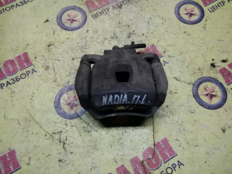 Суппорт Toyota Nadia ACN10 1AZ-FSE передний левый