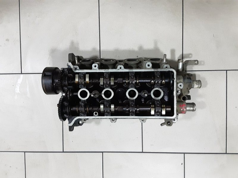 Головка блока цилиндров Toyota Vitz SCP10 1SZFE 2000 передняя