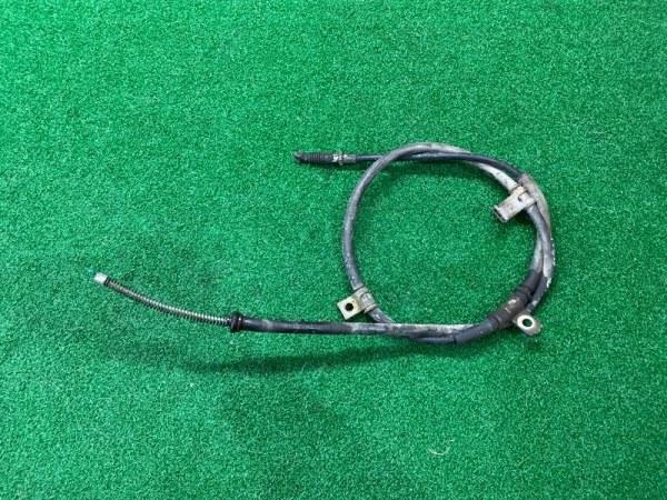 Тросик ручника Mitsubishi Pajero Io H76W левый (б/у)