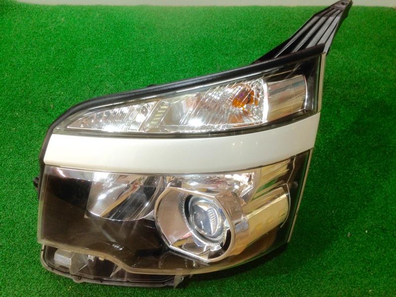 Фара Toyota Voxy ZRR75 левая (б/у)