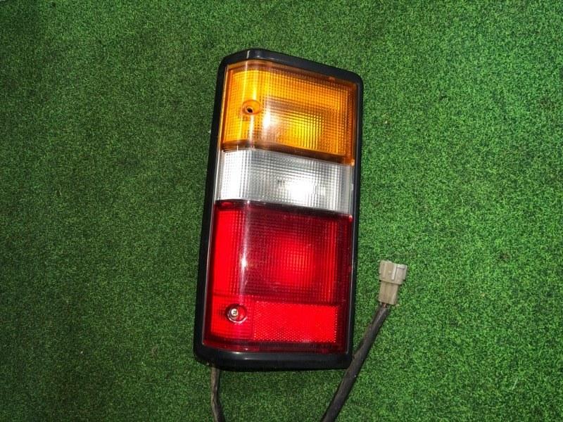 Стоп сигнал Nissan Caravan E24 левый (б/у)