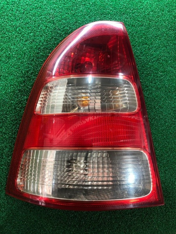 Стоп сигнал Toyota Corolla Fielder NZE124 левый (б/у)