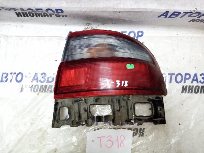 Фонарь задний правый Toyota Carina E AT190 задний правый (б/у)
