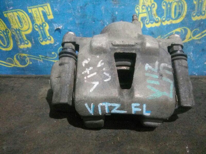 Суппорт Toyota Vitz NCP10 передний левый