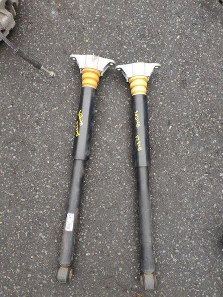 Амортизатор Mazda Axela BM5FS задний левый (б/у)