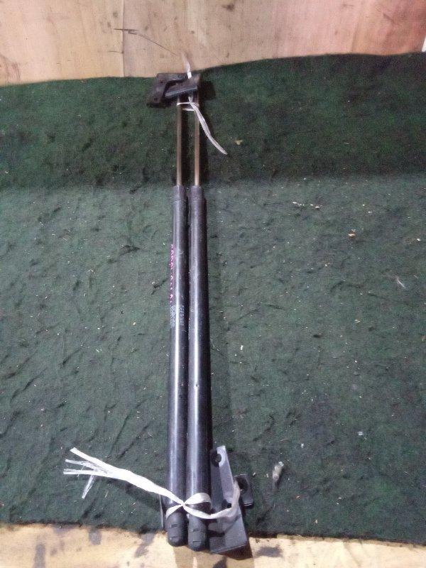 Амортизатор 5-ой двери Nissan Caravan CWMGE24 QD32 задний (б/у)