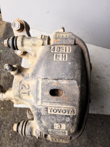 Суппорт Toyota Starlet EP81 4E FE 1989 передний левый (б/у)