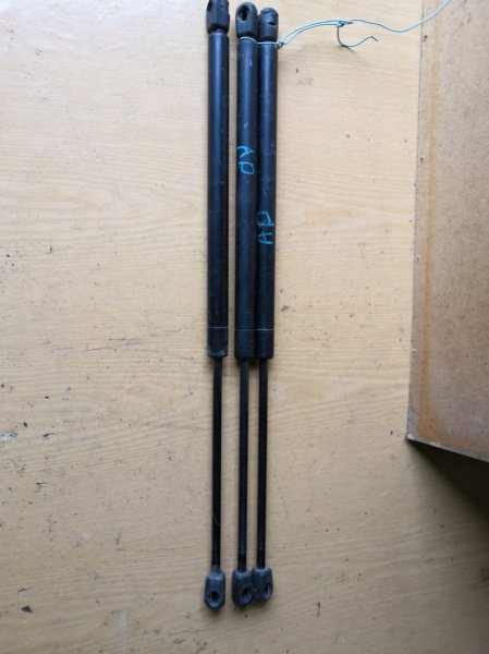 Амортизатор багажника Nissan Ad Y11 задний (б/у)